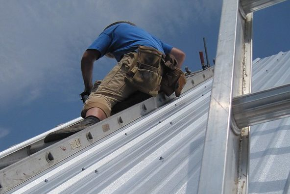 Roofers are installing metal roof
